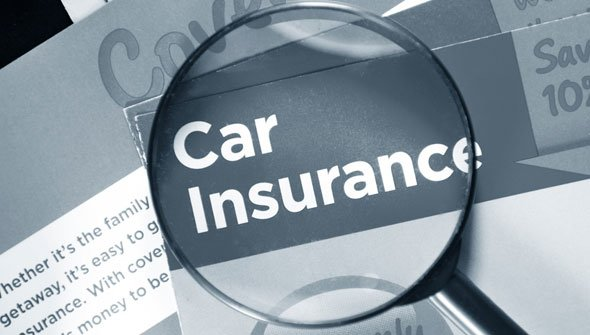 Magnifying glass over car insurance words