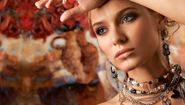 Women modelling all types of jewelry