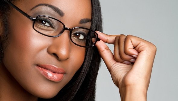 Articles of Incorporation Photo. Woman staring at the camera adjusting glasses