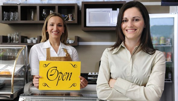 Two women excited to open their new business